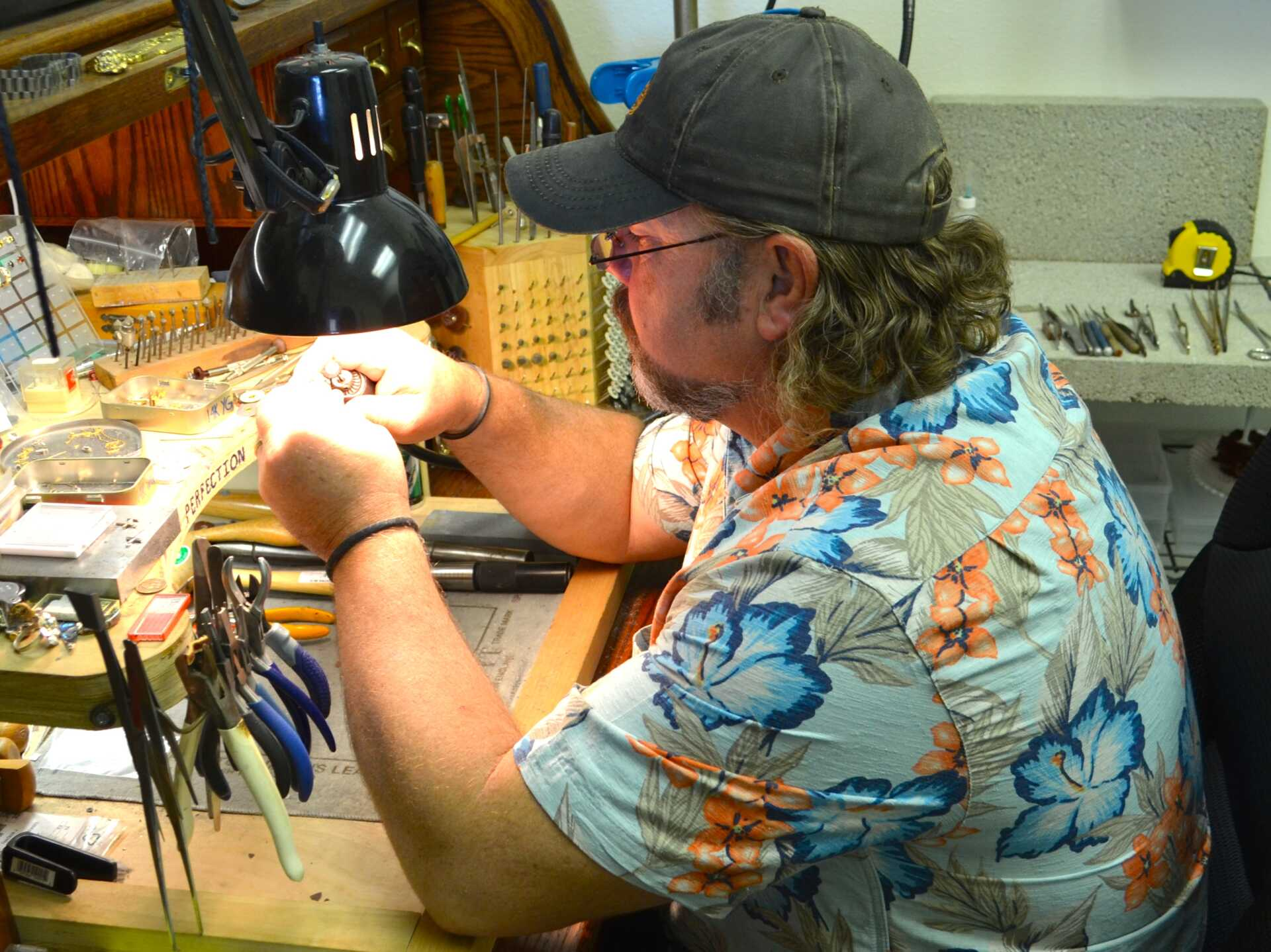 Steve Burrus, our Artisan Jeweler, hard at work repairing jewelry.